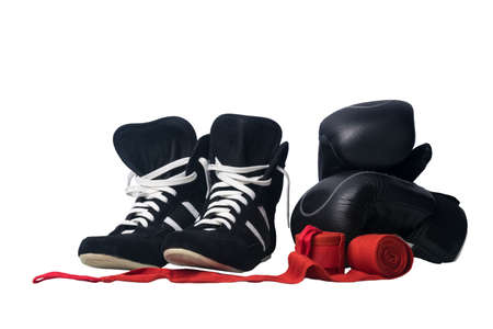 black wrestling shoes, black boxing gloves and unwound red protective bandages for martial arts isolated on a white background