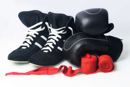 boxing concept: shoes and training equipment, isolated on white