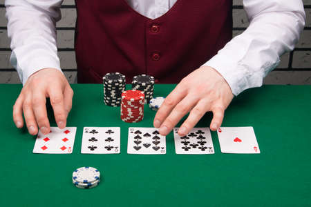 the dealer opened the cards in the game of poker