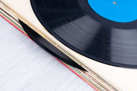 background of several vinyl records in paper packaging, top view Banco de Imagens