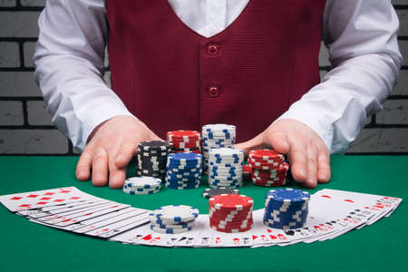 close-up of cards and chips, the dealer increases the bet