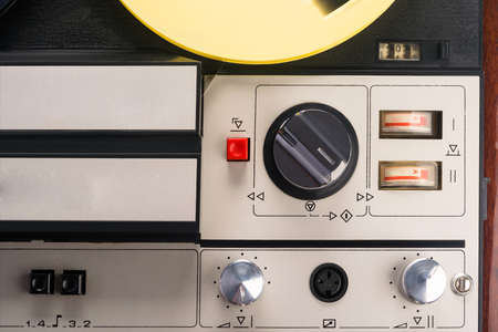 background of the top of an old tape recorder, close-up
