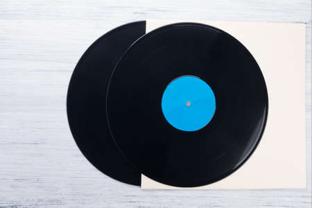two old vinyl records lie on paper packaging, top view