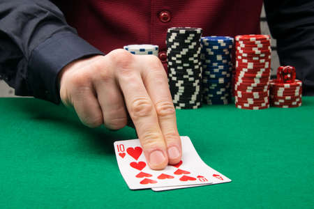 two blackjack playing cards on the green baize table in the casino