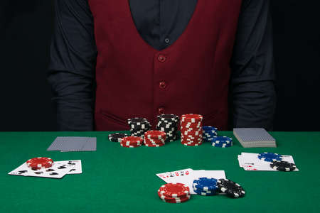the process of playing poker on a green table in front of the dealer