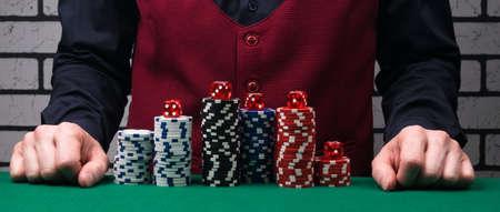 the concept of poker chips in front of the dealer Reklamní fotografie