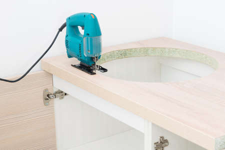 equipment for cutting a hole for a sink in kitchen furniture