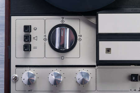 close-up of retro magnetic film player switches, background