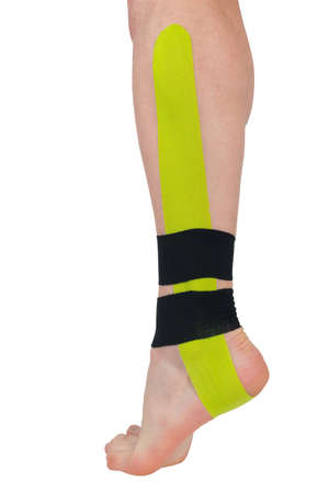 on the ankle of the leg, a fixing tape is pasted, for pain in the joints and muscles 写真素材