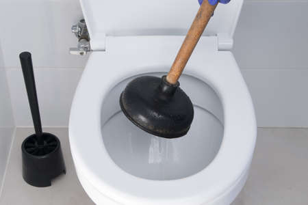 close-up of the elimination of the blockage of the toilet sewer