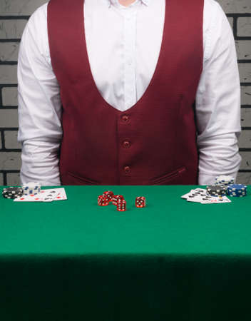 gambling background, casino staff in front of a green table with red dice on it