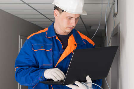 a worker configures the security of the network in the building
