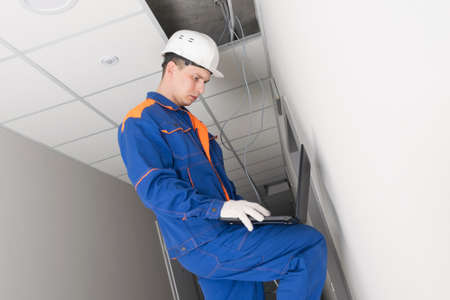 a worker checks the security of the network in the building