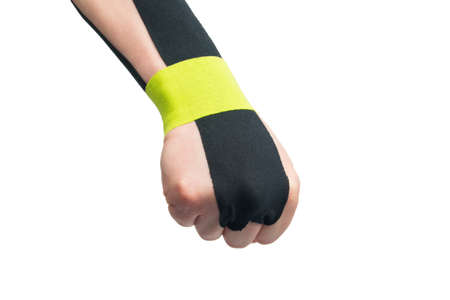 the   tape is pasted on the arm, to protect against injury during sports, on a white background, close-up Standard-Bild