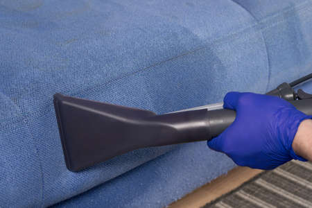 close-up of the cleaning vacuum cleaner brush, removes difficult dirt from the sofa textiles