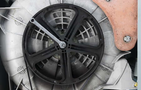 repair of the drive and belt of the washing machine, close-up, background Standard-Bild