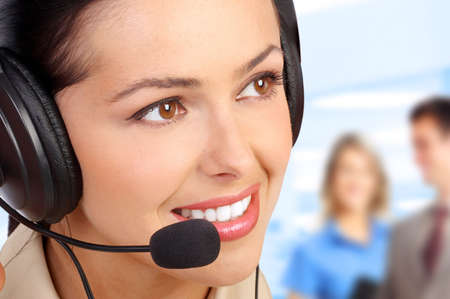 sales call: Smiling business woman with headset in ufficio