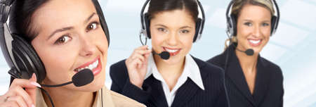 sales call: Smiling  business women  with headsets in the office  Stock Photo