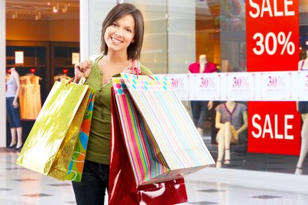 purchaser: Happy shopping  woman at the mall