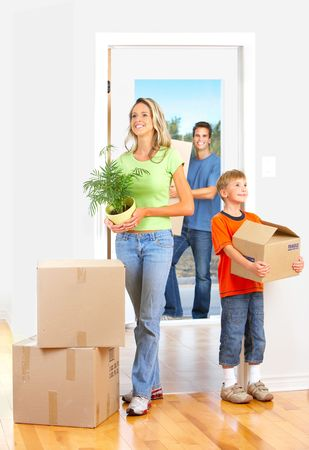 family moving house: Young happy family moving into their new home   Stock Photo