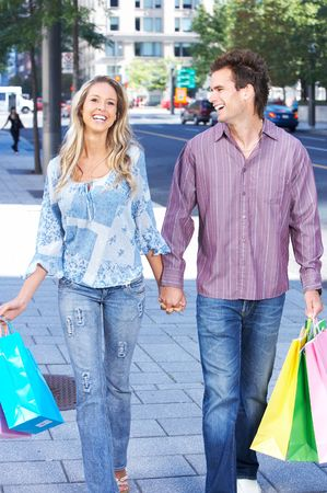 couple in summer: Shopping  smile couple on the street  Stock Photo