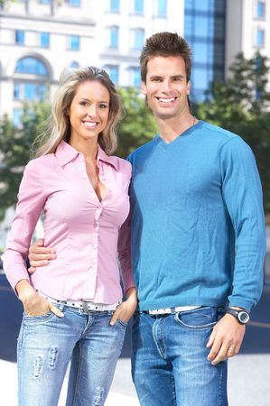 sexy couple embrace: Happy smiling couple in love walking on the street  Stock Photo