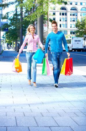 shopper: Shopping  smile couple on the street  Stock Photo
