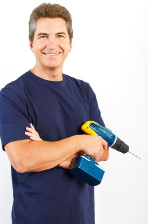 perforate: Handsome man with cordless hand drill. Renovation