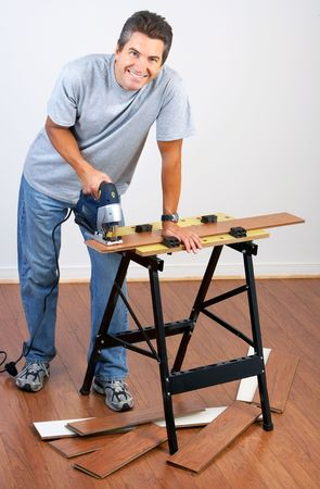 settler: Handsome smiling man working at home. Renovation