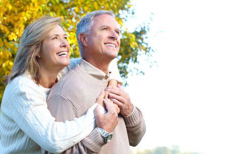 old man walking: Happy elderly couple in love in park