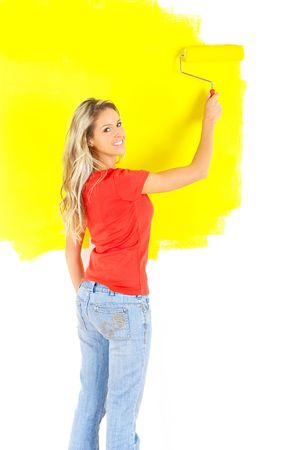 paintings: smiling beautiful woman painting interior wall of home.   Stock Photo