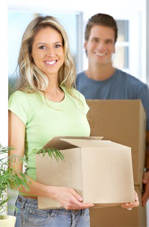 new entry: Young happy couple  moving into their new home   Stock Photo