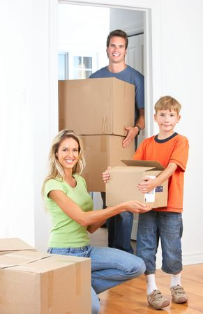 new entry: Young happy family moving into their new home   Stock Photo