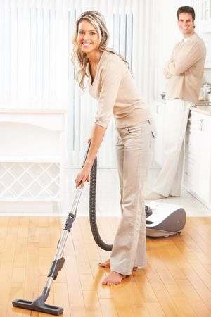 laundry room: Housework, vacuum cleaner, young couple, home, kitchen. Housework