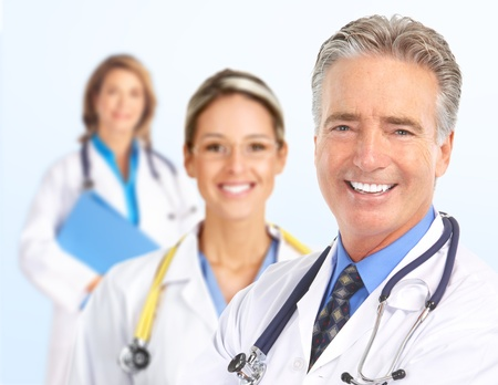 doctor surgeon: Smiling doctors with stethoscopes. Isolated over white background