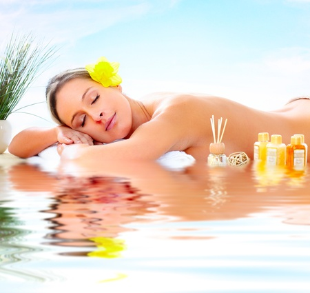 holistic therapy: Beautiful young woman getting spa massage. Relax Stock Photo