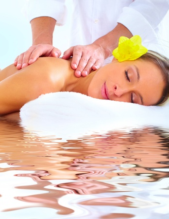 holistic: Beautiful young woman getting spa massage. Relax Stock Photo