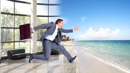 holiday stress: Businessman running on the beach  Summer vacation  Stock Photo