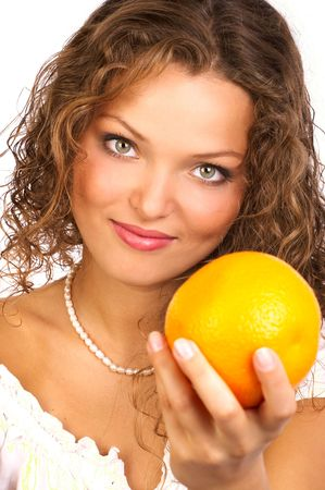 Pretty smiling woman offering you an orange photo