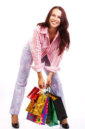 Christmas shopping pretty woman  with shopping bags. Isolated over white background Stock Photo - 595594