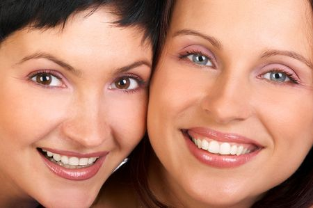 Two beautiful young happy girlfriends laughing. Close-up Stock Photo - 595576
