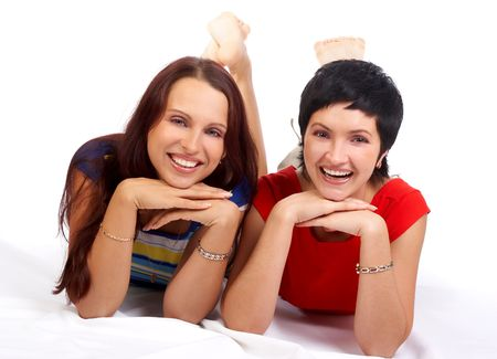 Two beautiful young happy girlfriends laughing. Isolated over white background Stock Photo - 595577