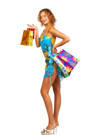 Christmas shopping pretty woman  with shopping bags. Isolated over white background Stock Photo - 595574