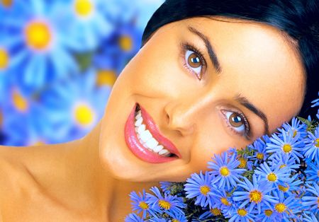 Happy young smiling woman with flowers
