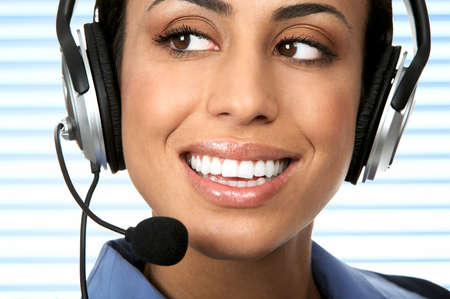Smiling pretty agent  woman with headset. Stock Photo - 2405641
