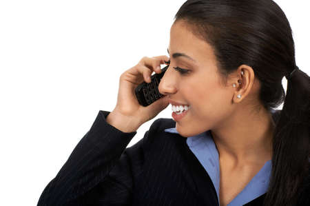 Eastern business young woman calling by cellular phone.