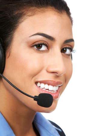Smiling pretty business woman with headset. Over white background Stock Photo - 2405663