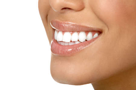 tooth care: Beautiful young woman teeth. Isolated over  white background   Stock Photo