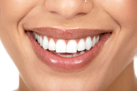 tooth care: Beautiful woman smile. Isolated over  white background  Stock Photo