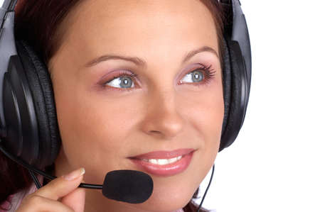 Serious  pretty business woman with headset. Over white background 